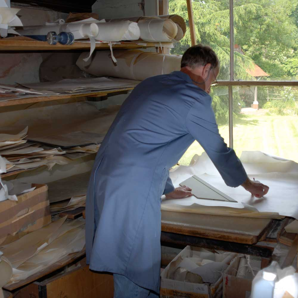 """Selecting sheepskin parchment sheet by sheet. <small><a href=""""https://www.facsimile-editions.com/copyright/"""">© Copyright 2021 Facsimile Editions Ltd</a></small>"""