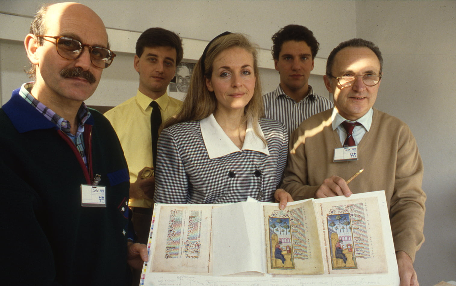 """Linda Falter and the Italian 'team' comparing the unbound Rothschild Miscellany manuscript with second proofs at the Israel Museum, Jerusalem. <small><a href=""""https://www.facsimile-editions.com/copyright/"""">© Copyright 2020 Facsimile Editions Ltd</a></small>"""