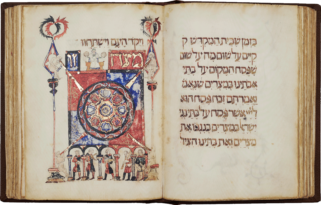 """Folio 61r. The most commonly decorated image in the haggadah depicts the matzo. This is a particularly lavish rendering and might symbolise the cosmos. According to this theory, the matzo is formed of eight concentric circles with five earthly musicians in the arcades. The nude trumpeters in the corners perhaps personify the Four Winds representing universal harmony. The coats of arms are said to represent the shield of Barcelona hence the naming of this haggadah. <small><a href=""""https://www.facsimile-editions.com/copyright/"""">© Copyright 2020 Facsimile Editions Ltd</a></small>"""