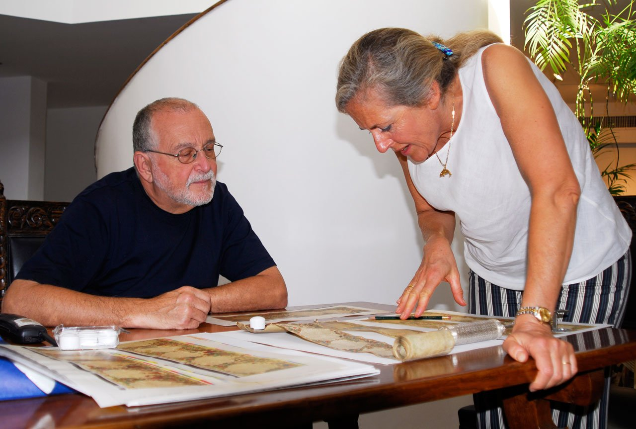 """William Gross discussing the first proofs with Linda Falter  <small><a href=""""https://www.facsimile-editions.com/copyright/""""> © Copyright 2021 Facsimile Editions Ltd</a></small>"""